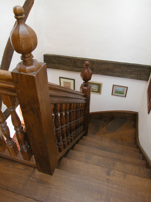Oak Stairs with Heavy Handrail and Newel sections and Faceted Newel Caps