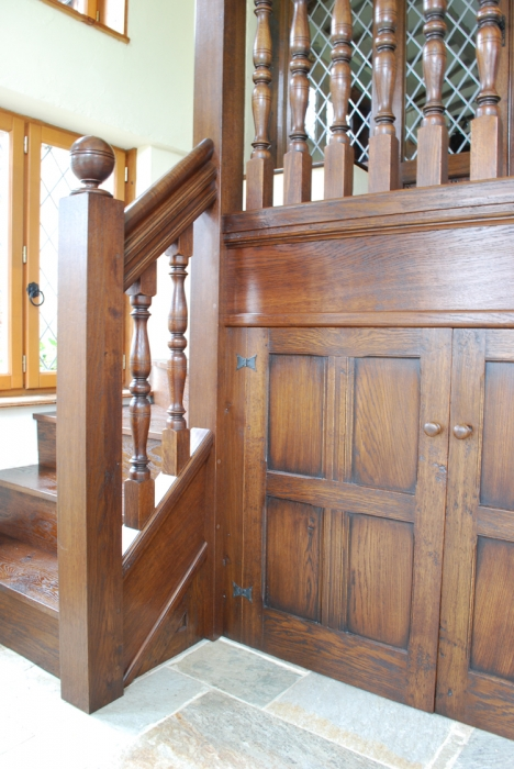 Making full use of limited space with Cupboards under a low Oak Stairway