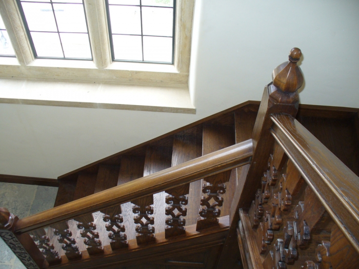 Oak Staircase with Hand Carved Newels and Finials, together with Fretted Splats