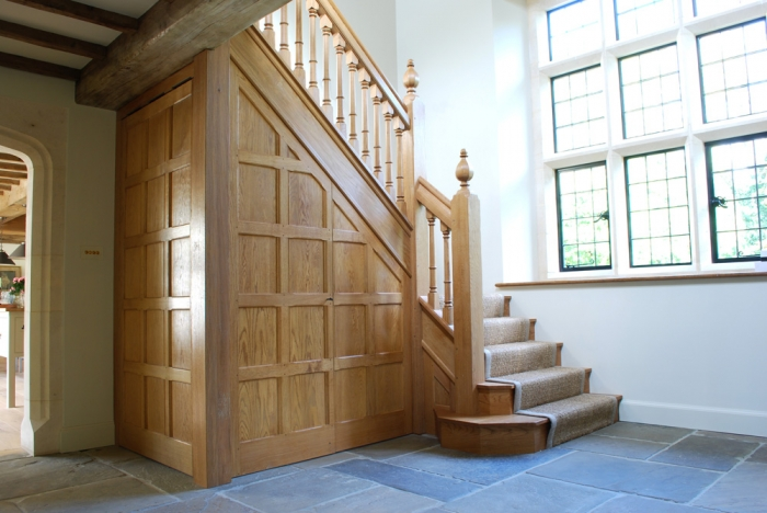 Light Oak Staircase with Double Bullnose Treads,Panelled Under-stairs Cupboard accessed through Jib Doors