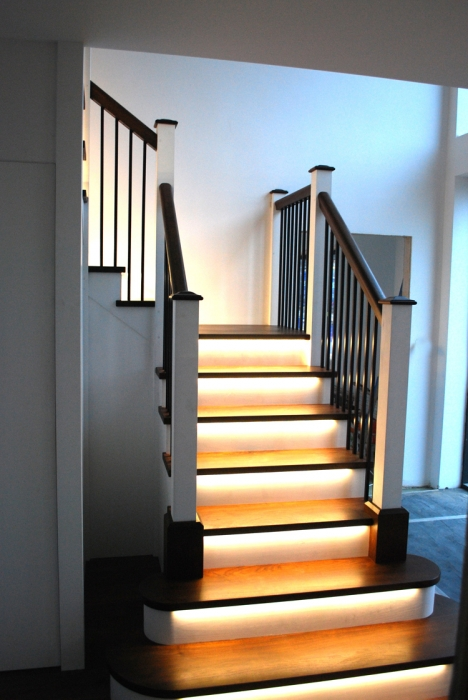 Staircase with Black Walnut Treads, Handrails and Cappings with Black Powder Coated Balustrades