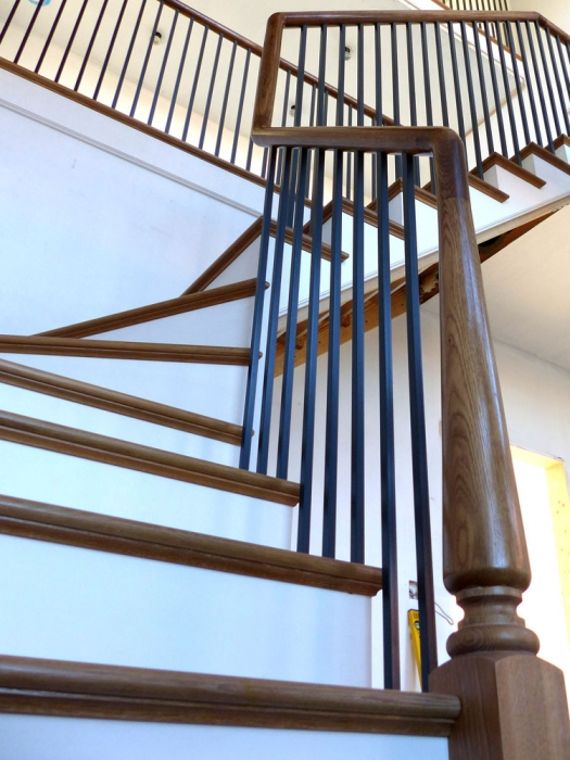 Oak Staircase with Continuous Handrail and Solid Oak Treads with Painted Risers and Metal Balustrades