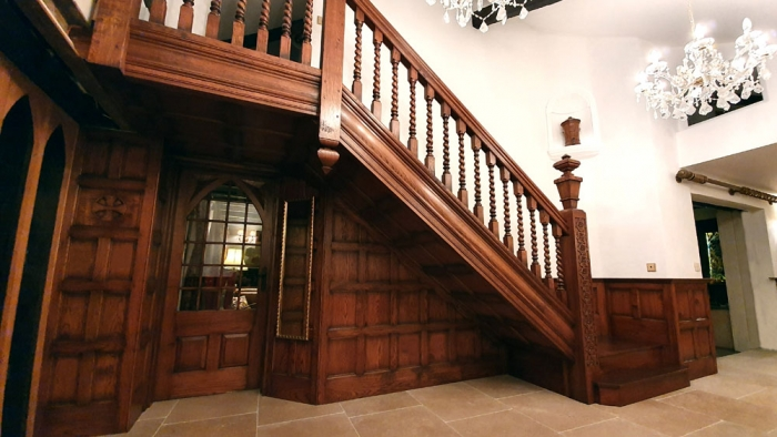 An impressive bespoke hand crafted oak staircase and panelling
