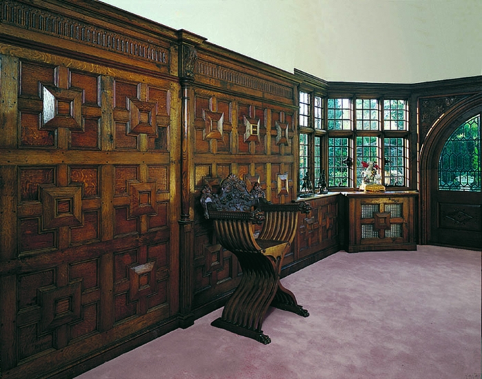Geometric Oak Panelling with Turned and Carved Pilasters and Carved Frieze