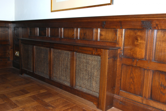 Dado height Oak Panelling with built in Radiator Cover
