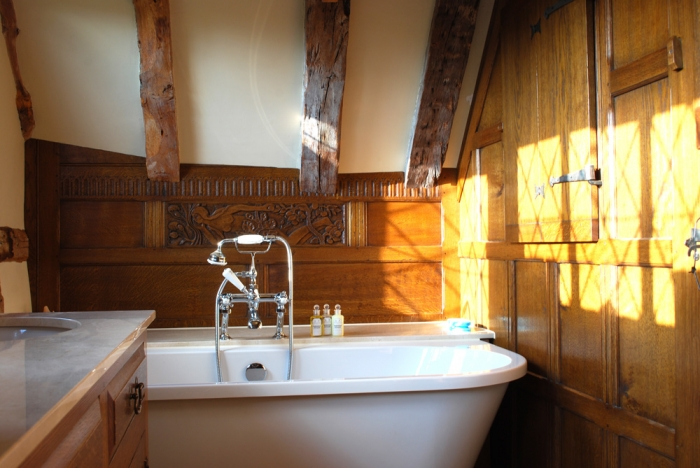 Oak Panelled Screen with Boarded Door and Window Shutters, the Bath Panel has been Scribed to fit the ceiling and beams
