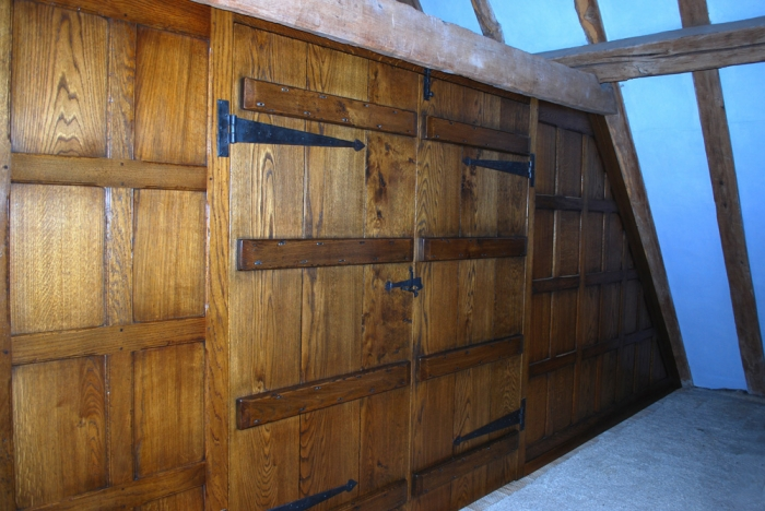 Oak Panelled Screen with a pair of Ledged Doors 