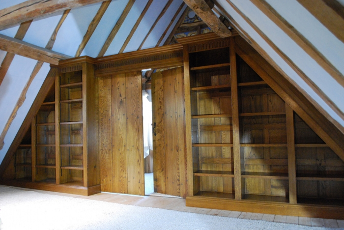 Panelled Oak Bookcase Screen with a pair of Boarded Doors and Hand Carved Rails with a Large Cornice