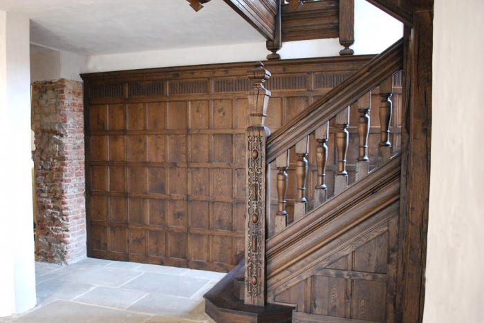 Solid Oak Wall Panelling with a Jib Door and a Hand Carved Frieze and Solid Oak Staircase with Hand Carving