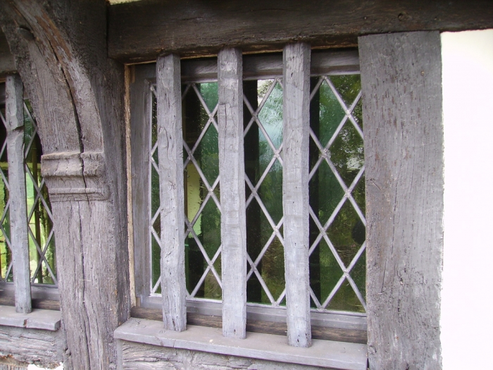 Early Oak Barred Window backed with Traditional Lead Lights