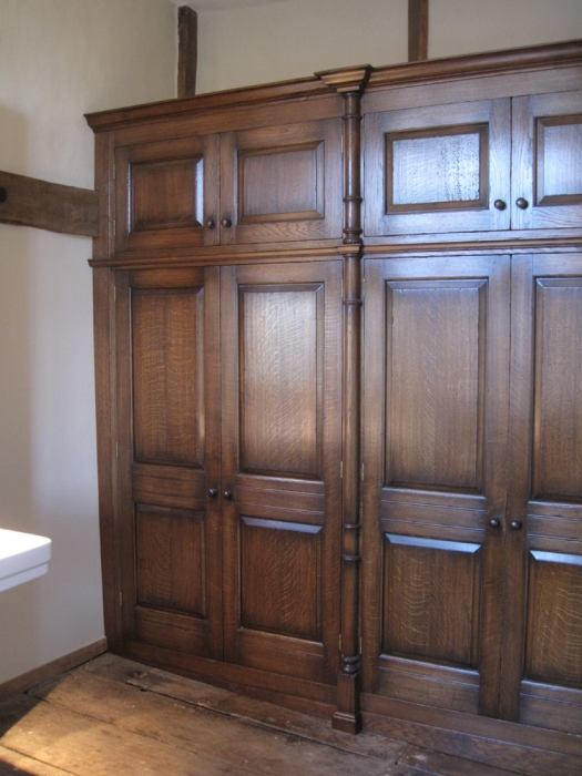 Oak Fitted Wardrobe with Cupboards Over and Split Turned Decoration