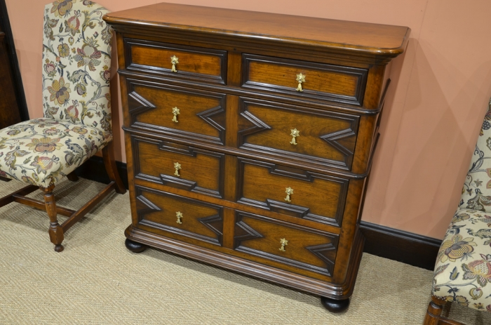 Chest of Drawers with Geometric Moulded Drawer Fronts and Solid Brass Handles, made from Cherry and Walnut
