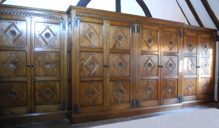 A Magnificent Fitted Solid Oak Wardrobe with Hand Carved Panels