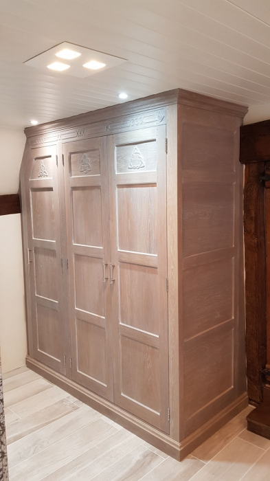 Solid oak bespoke Wardrobe with hand carved panels