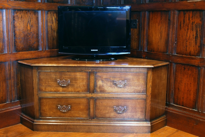 Distressed Oak Corner Television Cabinet with Brass Handles, the bottom left drawer is false, it is a Drop Down Flap with an adjustable shelf inside to house Media Equipment
