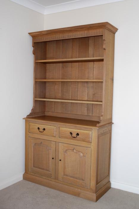 Light Oak Dresser and Rack,when opened the doors slide inside the Dresser