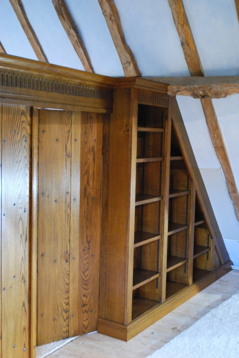 Fitted Oak Bookshelves with Hand Carving