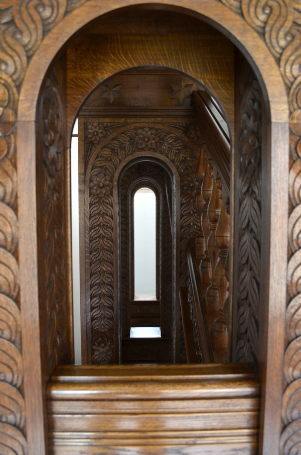 Showing some of the column arch Hand Carved detail of the Oak Staircase