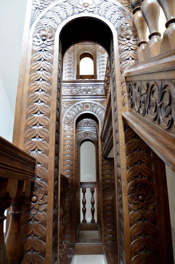 Oak Staircase, looking up through the arched columns and showing the Hand Carving of the Strings
