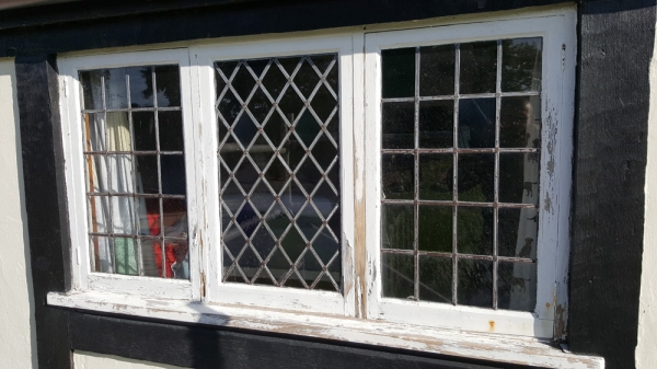One of the original softwood windows in need of replacement