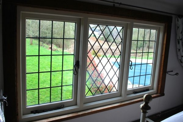 Slim double glazed windows with lead lights