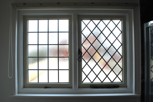 Opaque bathroom window with double glazed lead lights and black ironmongery
