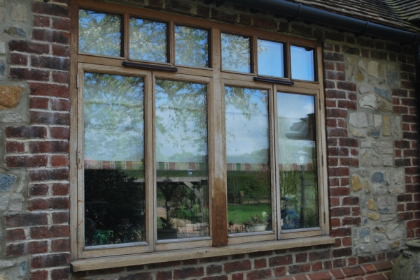 Dull and faded Oak Window Frame