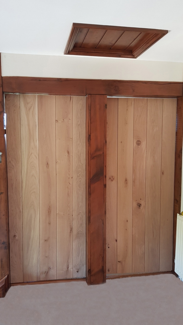 Ledged Doors with narrow boards, being fitted