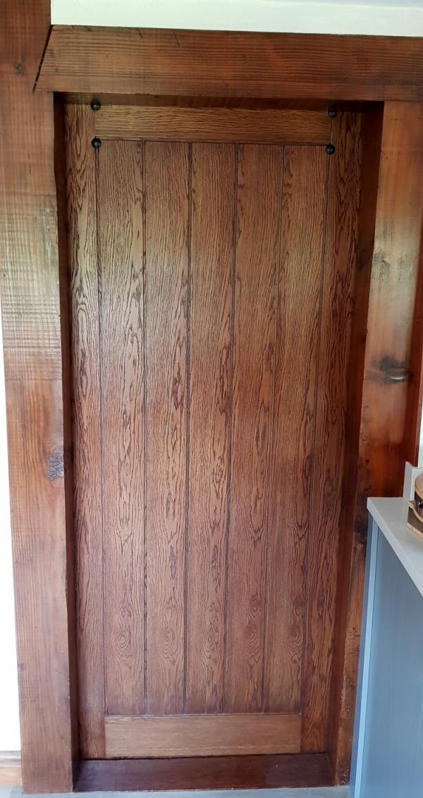 The Veneered side of the Oak Sliding Door