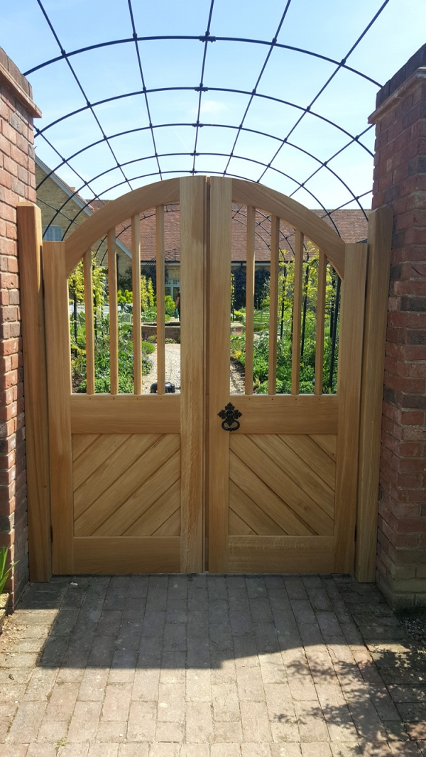 A pair of Oak Garden Gates with boarded lower section and an Open Mullioned Top