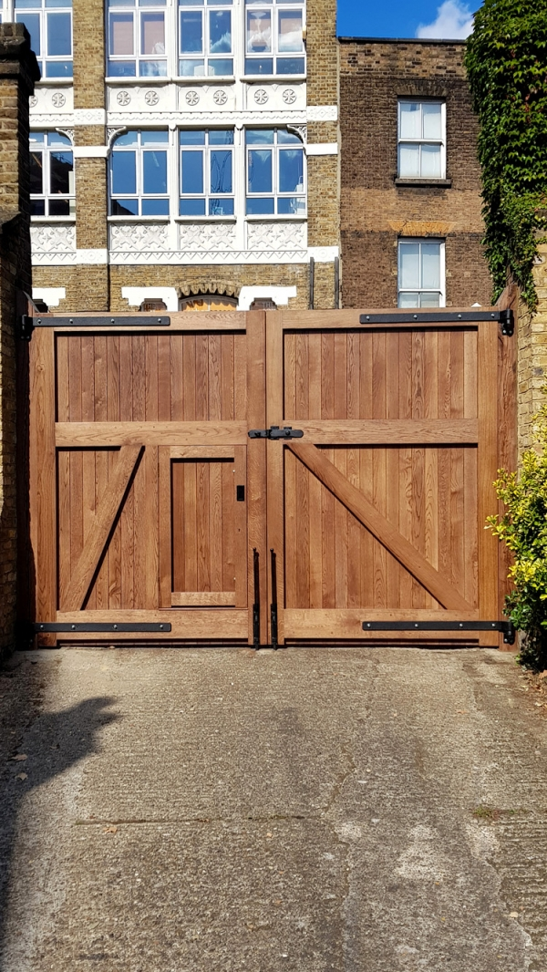 A pair of Large Solid Oak Entrance Gates with Bespoke Ironmongery