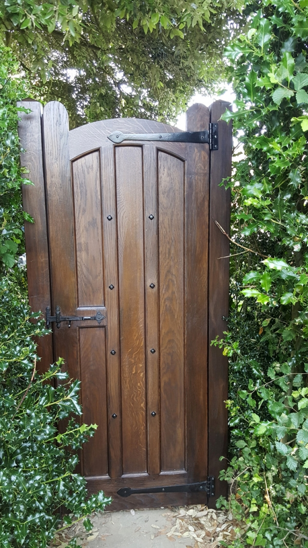 A Dark Stained Solid Oak Garden Gate with Black Ironmongery