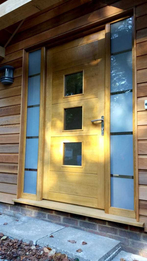 A Contemporary Oak Front Door with Etched Glass Sidelights
