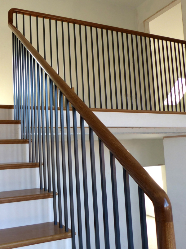 Continuous Handrail Staircase leading to Gallery with Black Powder Coated Balustrade