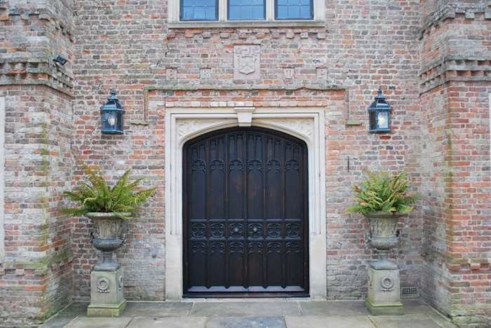 An impressive pair of Solid Oak Entrance Doors with Hand Carved Panels and a Heavy Sectioned Oak Frame