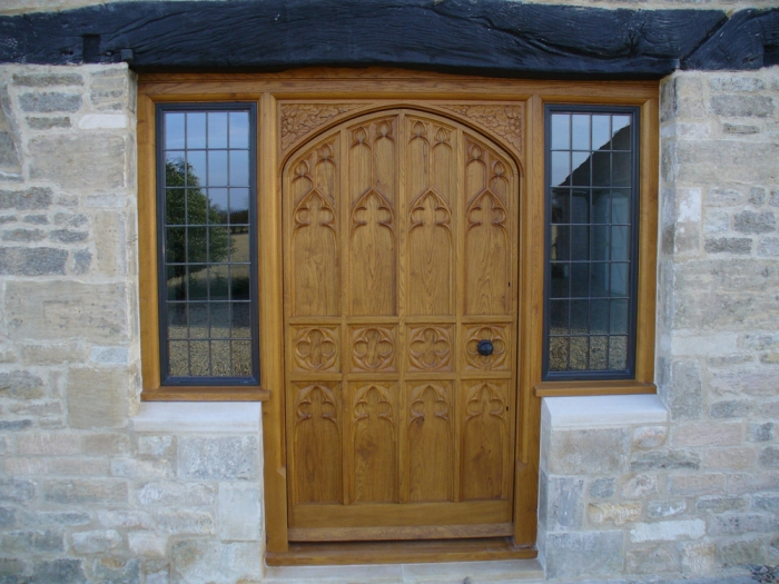 Bespoke Solid Oak Door with Hand Carved Panels a Hand Carved Frame and Bronze Casement Side lights