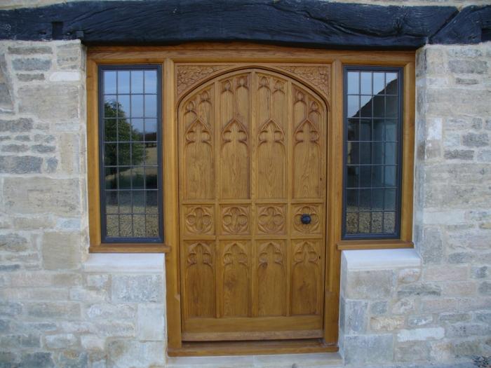 Bespoke Solid Oak Door with Hand Carved Panels a Hand Carved Frame and Bronze Casement Side lights