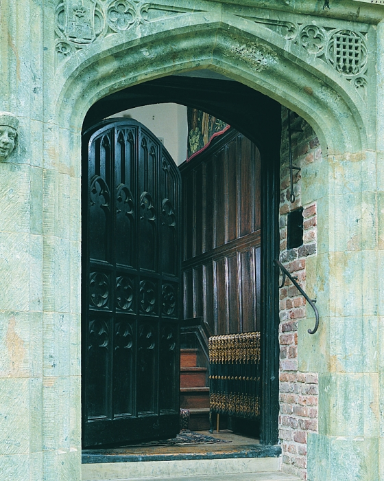 A large Heavy Gothic Carved Door with Hand Made Ironmongery