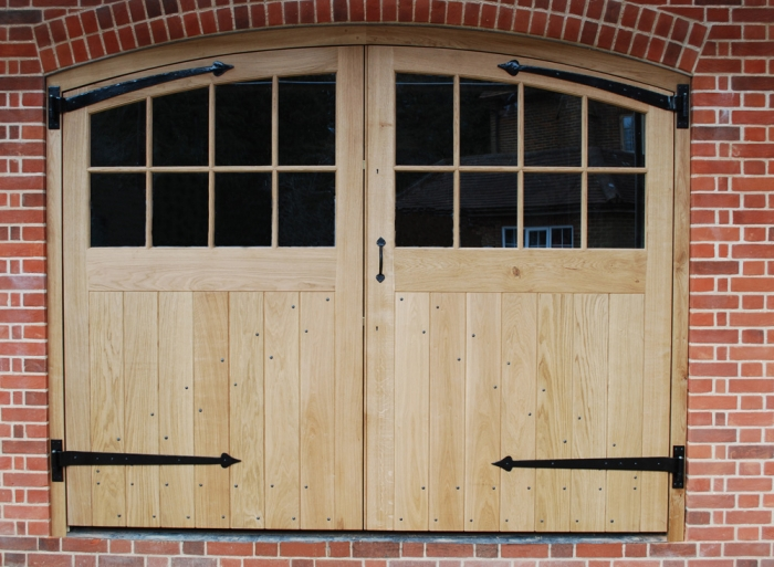 A pair of Solid Oak Garage Doors with Slim Double Glazed Units and Bespoke Hinges