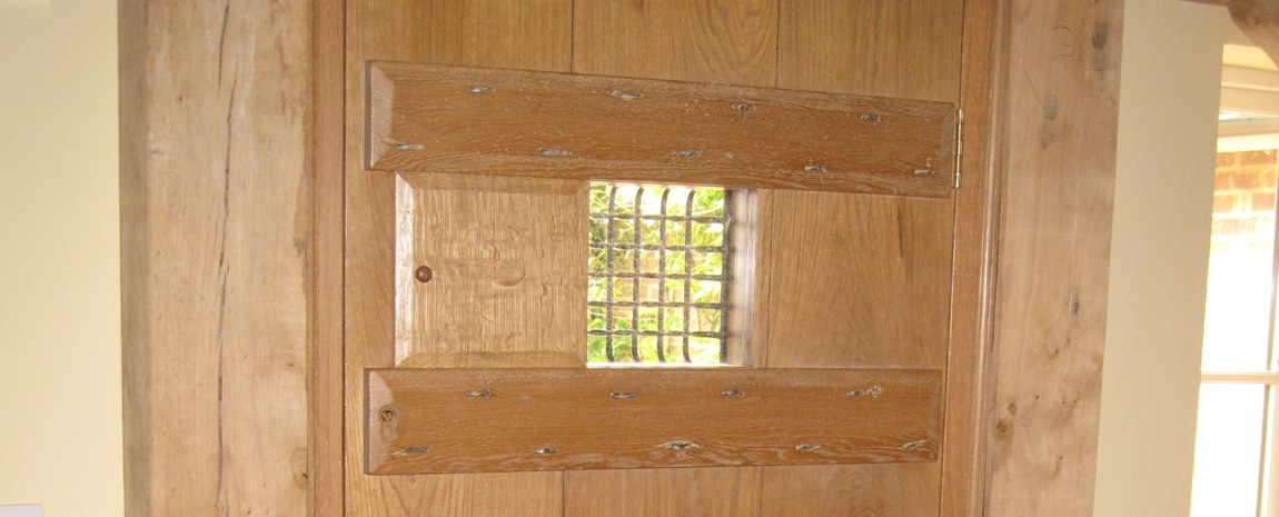 Solid Oak Boarded Exterior Door with External Grill and Viewing Panel