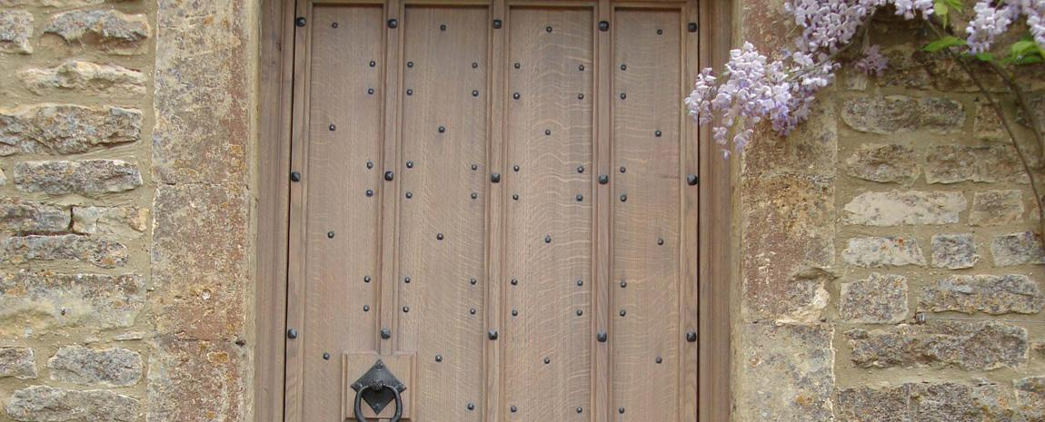 Solid Oak Planked Exterior Door with Cover Strips and Bespoke ironmongery